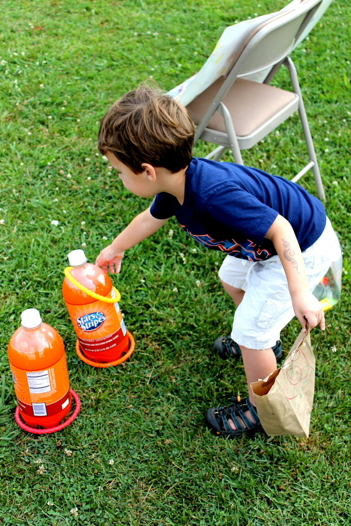 Toddler ring toss with soda bottles